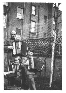 Bruno and children Claudio & Emilio with their accordions in the garden of their home